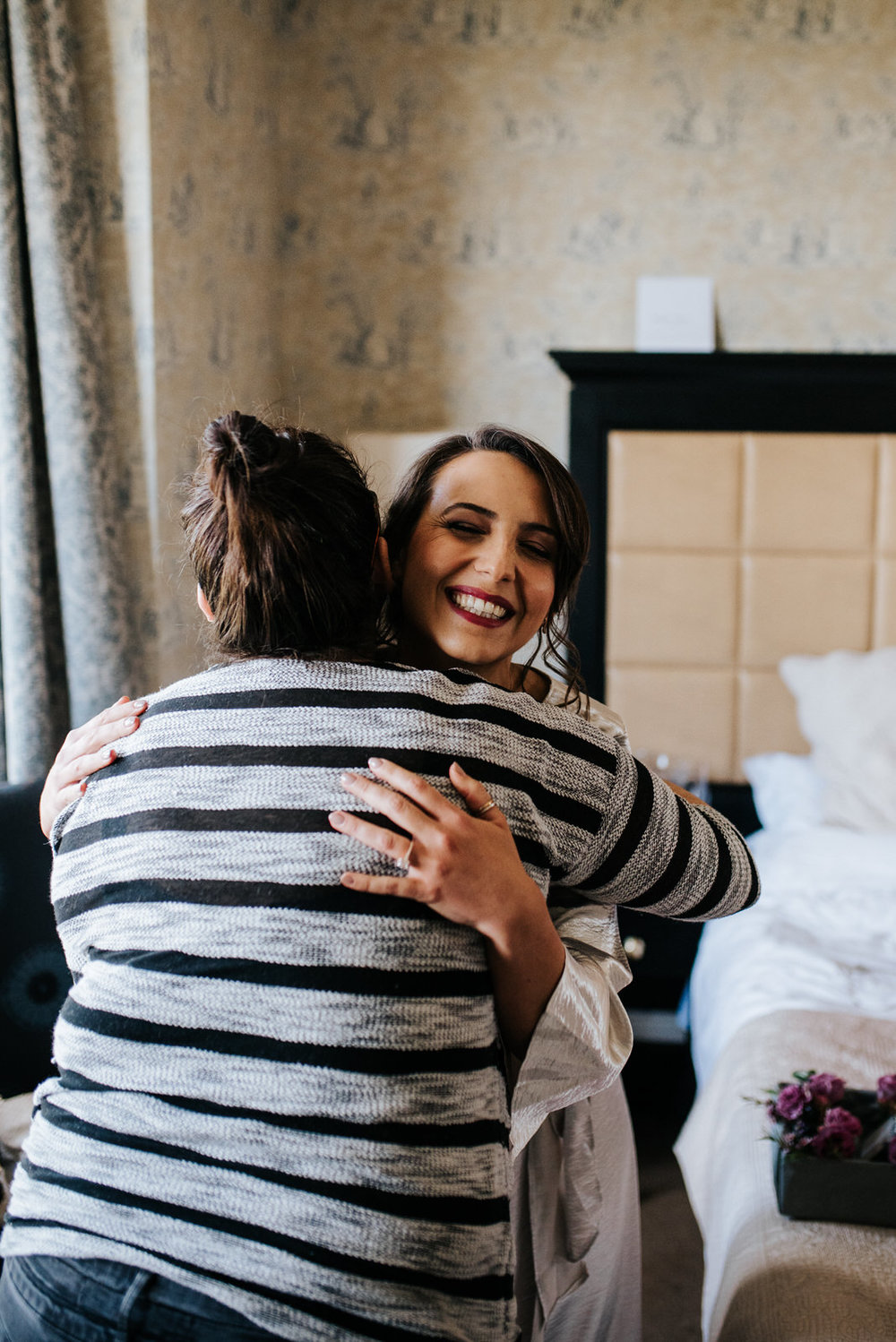 Bride hugs and thanks her make-up artist
