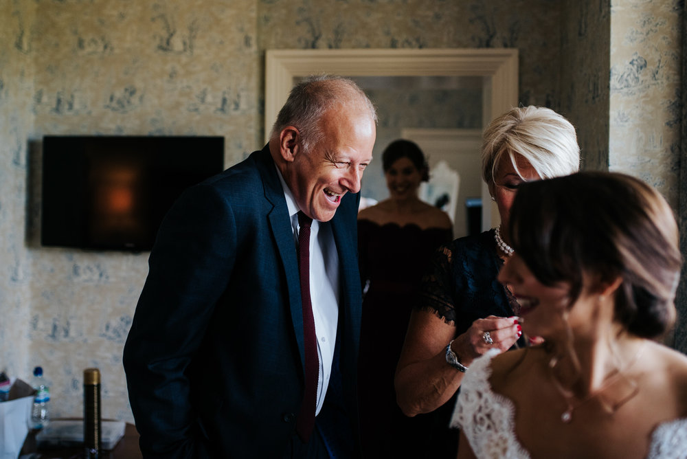 Bride's step-dad jokes around as he sees her in her dress