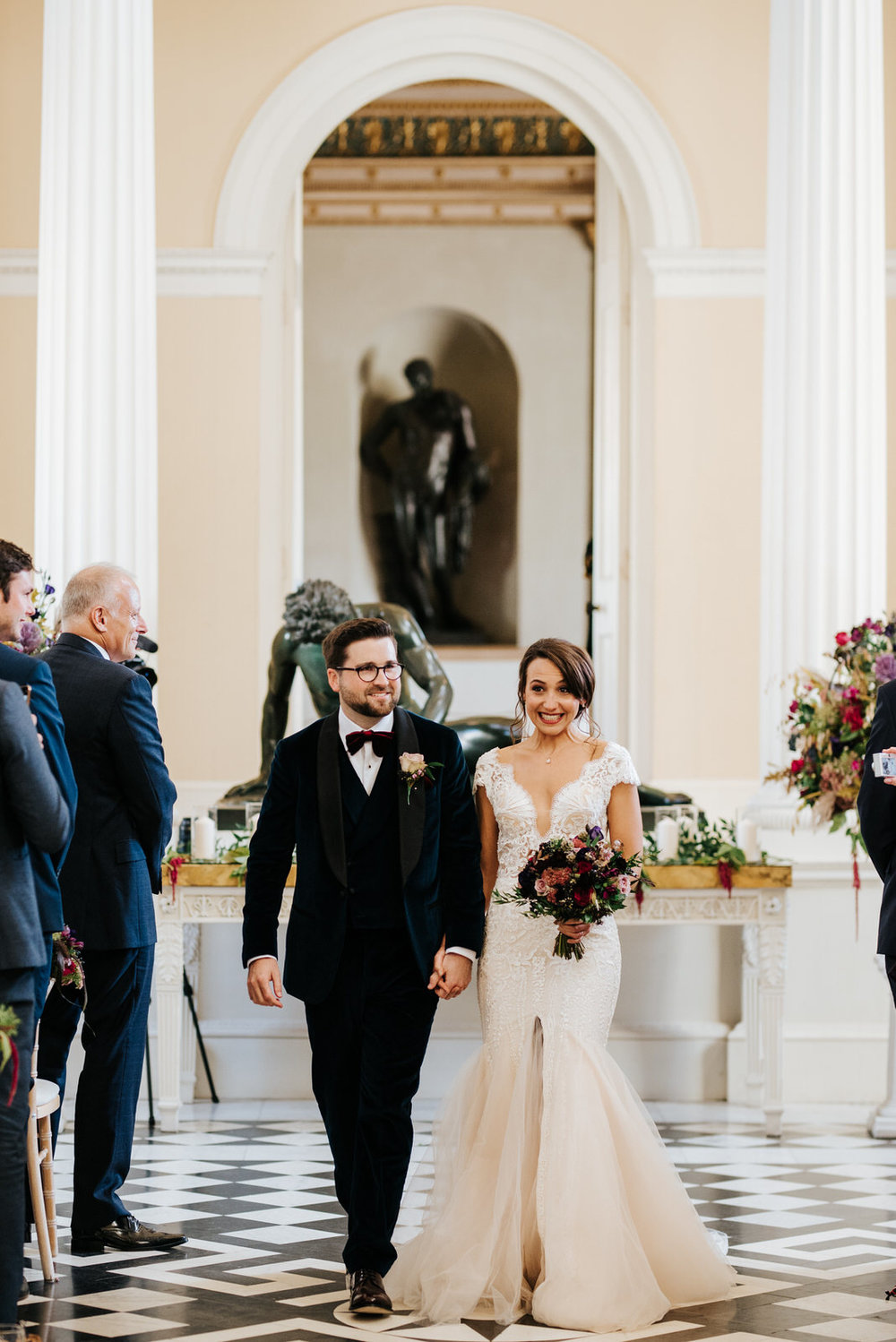 Bride and groom exit down aisle as a married couple