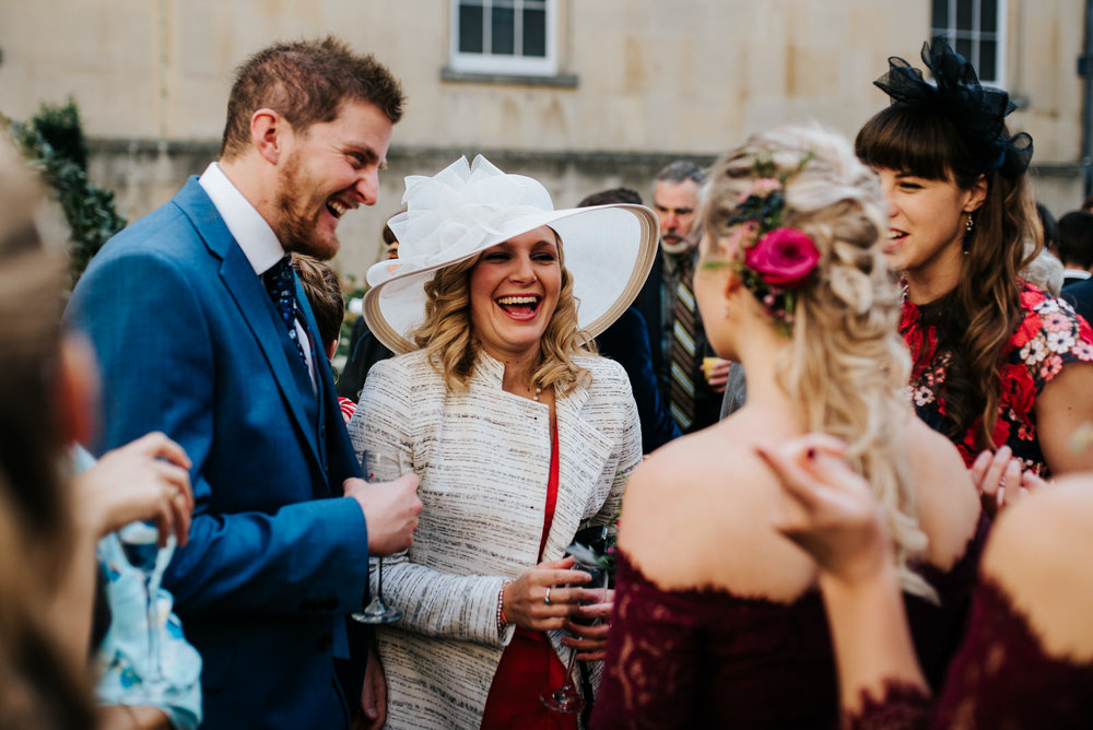 Candid moment of guests talking to each other after wedding ceremony
