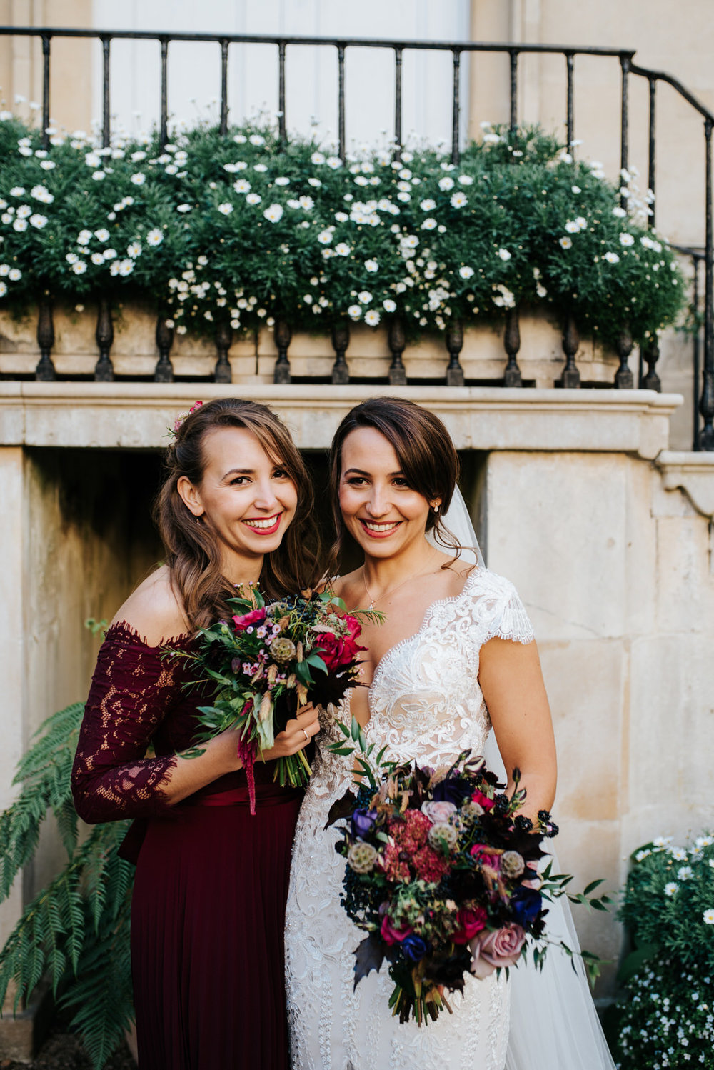 Posed photo of bride and her sister looking very natural