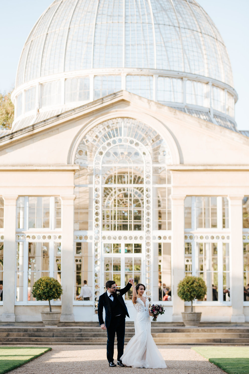Bride and groom dance in front of Syon House's great conservatory building