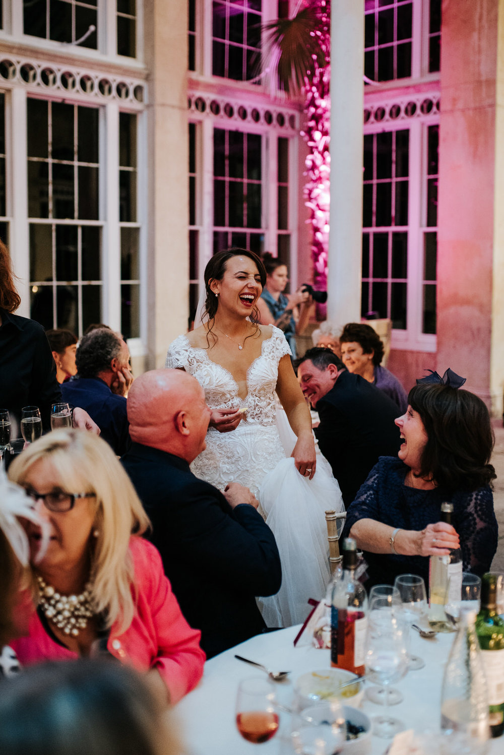 Bride can't contain laughter as she goes around tables saying hello to her guests