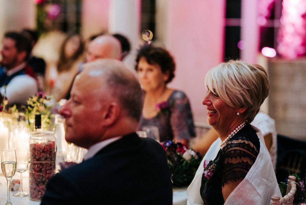 Bride's mum listen's to grooms speech and smiles