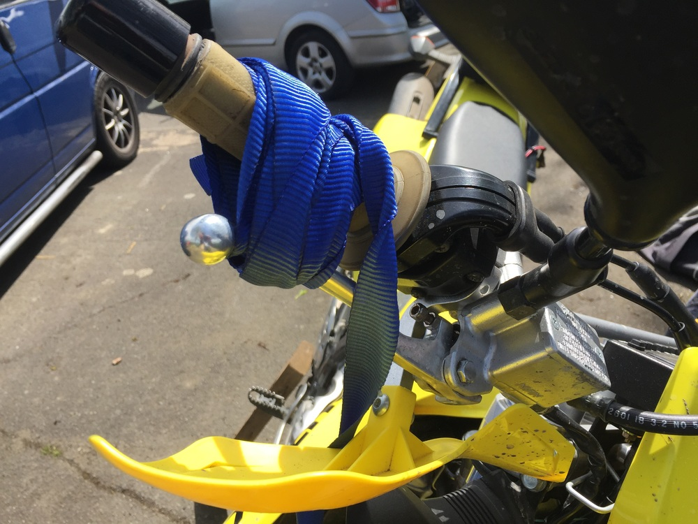 Using a strap to keep the front brake on