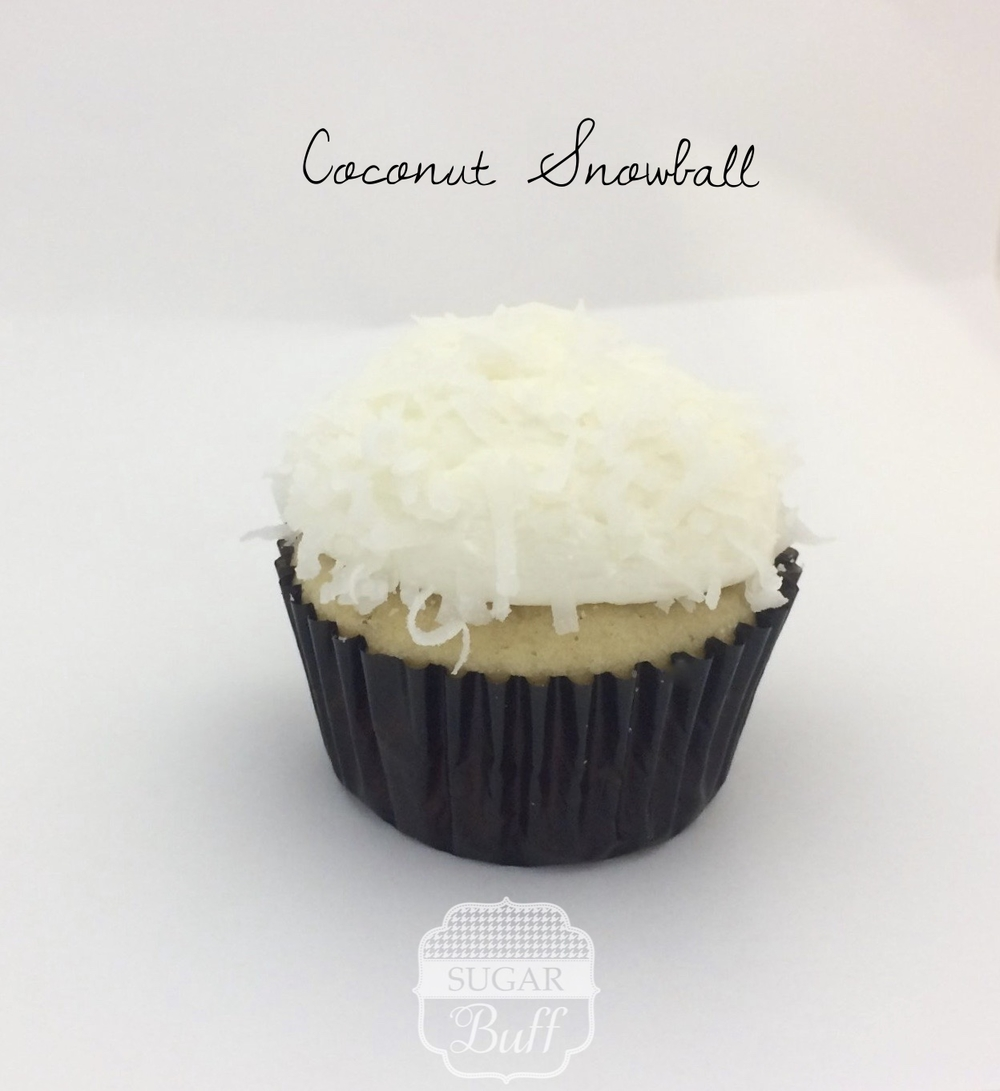 Coconut Cupcake with Coconut Buttercream frosting and topped with coconut