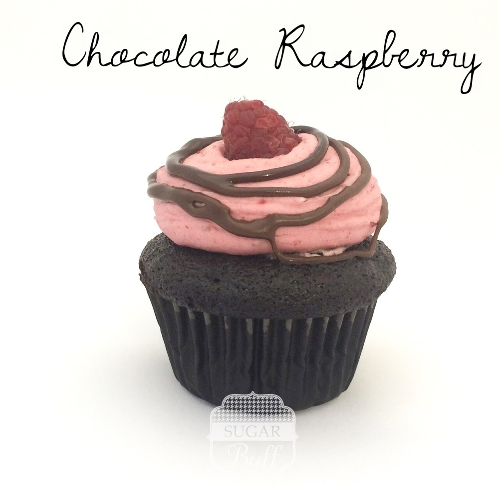 Chocolate Cupcake with Raspberry Buttercream Frosting topped with a chocolate drizzle and fresh raspberry