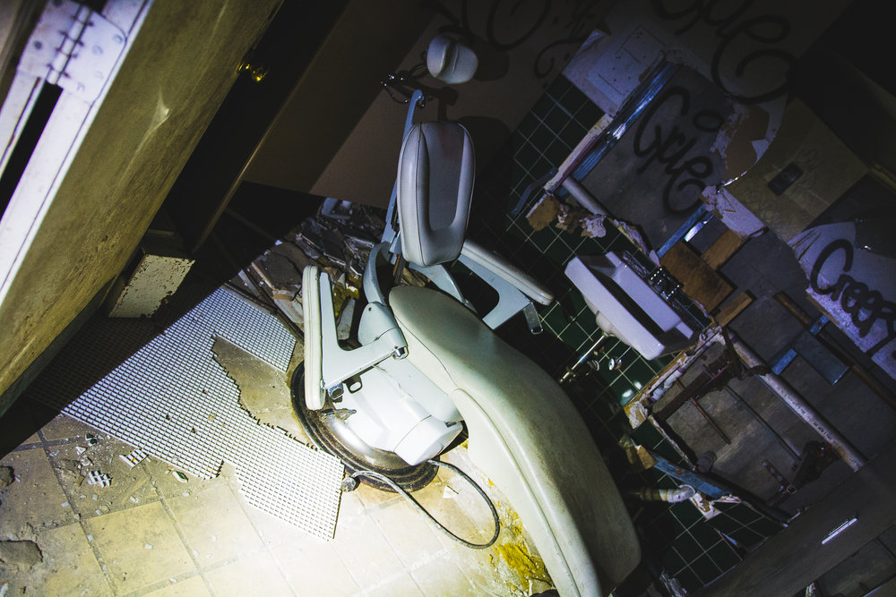 Creepy dentist chair in the old women's bathroom. The tour guide said they still don't know why it was in there.