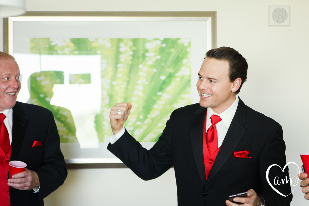 Groomsman laughs while getting ready at Hilton hotel on International Drive