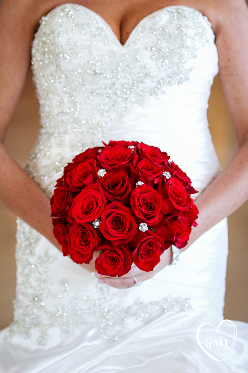 Gorgeous traditional red rose bridal bouquet from Central Florida wedding