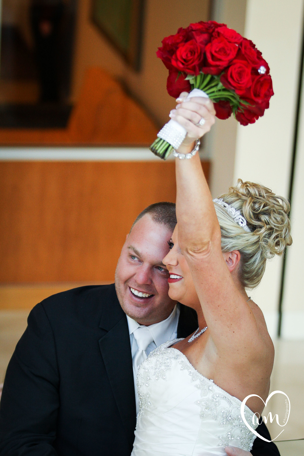 Bride and groom celebrate during first look before their orlando wedding
