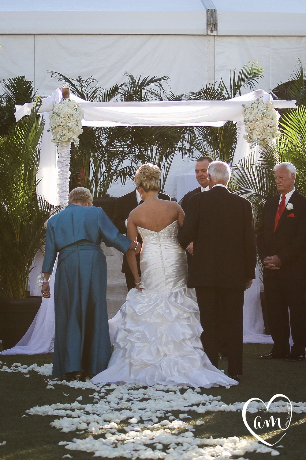 bride adjusts her dress during outdoor Orlando Florida wedding ceremony