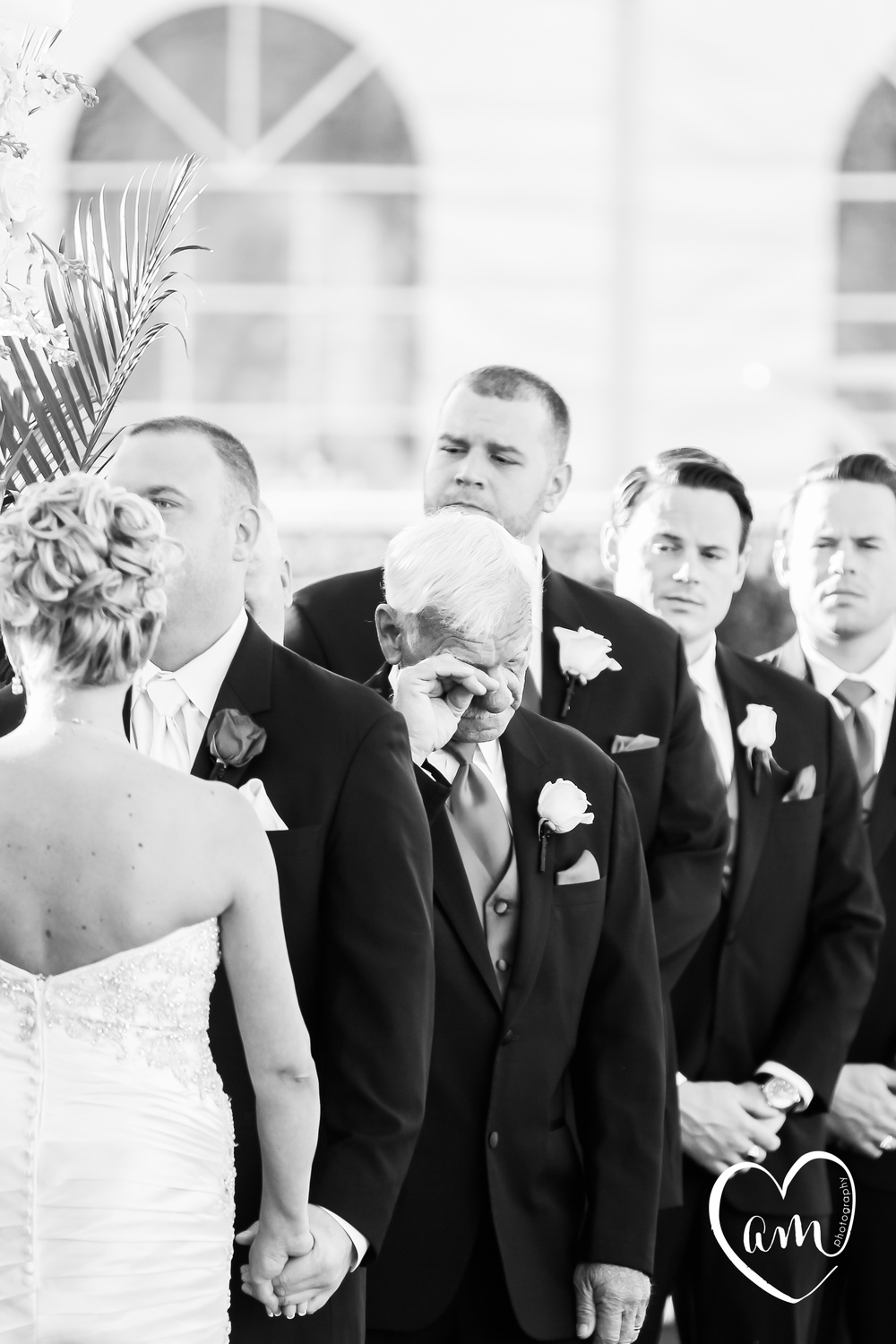 father of the groom cries during romantic outdoor wedding ceremony in orlando