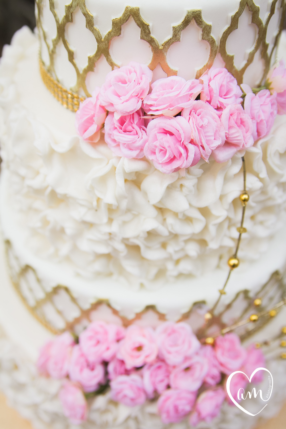 Pink and gold wedding cake photographed by Florida Destination Wedding Photographer