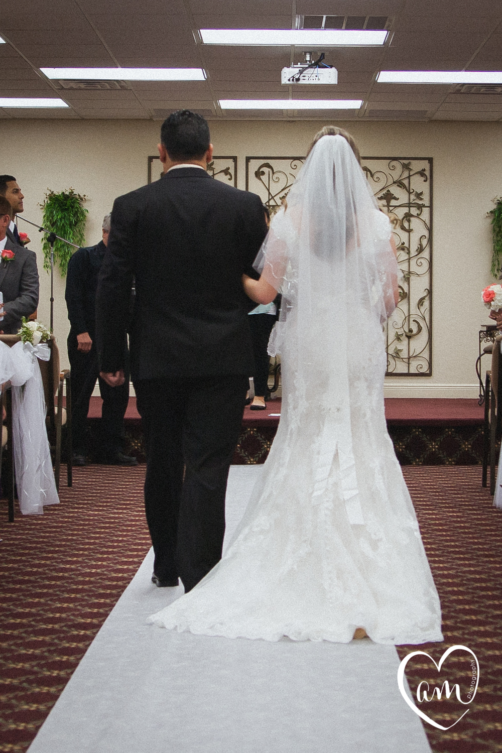 Bride's train as she walks up the aisle.