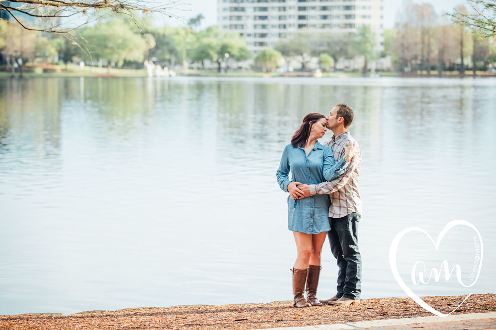 Engagement photos at Lake Eola. Church Street engagement session. Photo by Amanda Mejias Photography: Orlando wedding photographer.