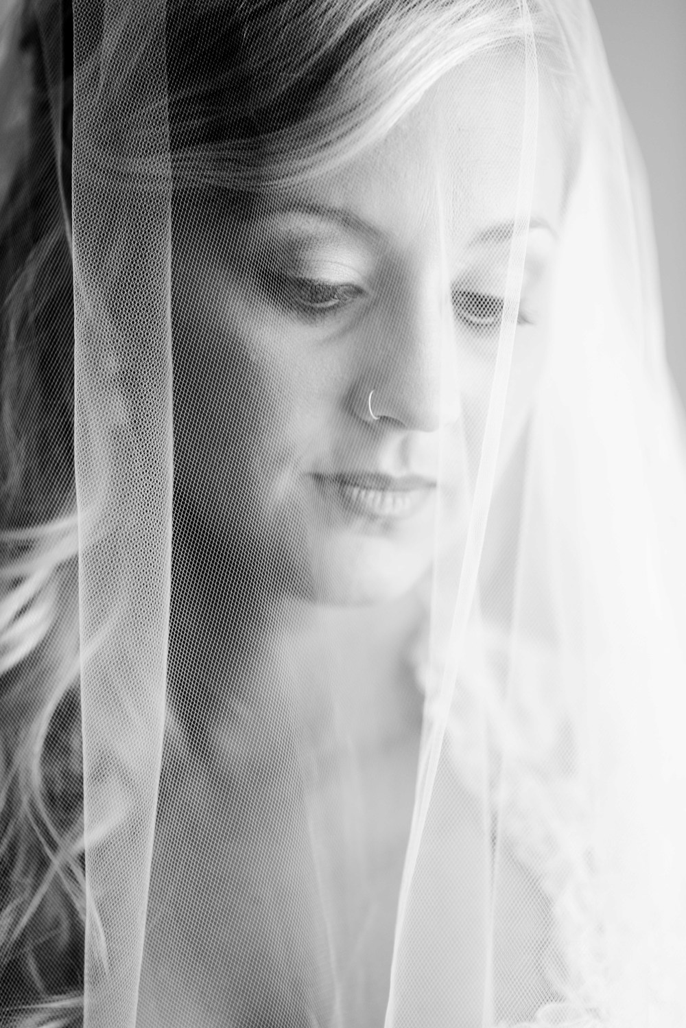 Anna's choice of a fingertip veil with lace edging perfectly suited her lace overlay satin bridal gown.