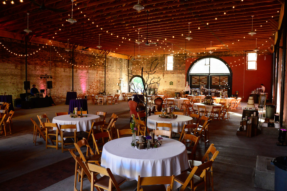 The Livery Stable located in downtown Abbeville SC transformed into the ideal setting for their vintage reception.  From Vintage furnitures to lounge around on to perfectly placed twinkle lights dangling from the rafters Greg Hall and Company nailed this look.