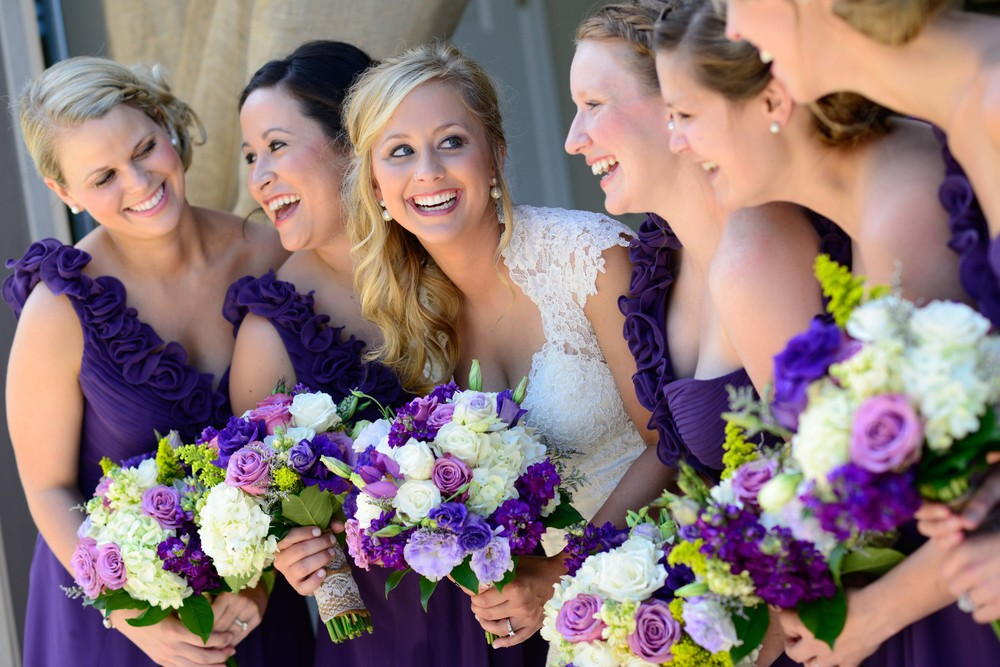 Every single time I look at this picture, I wish I knew what they were talking about to inspire this great reaction!  Anna really pulled her wedding theme together with these eggplant one sleeve bridesmaids dresses that coordinated perfectly with the lavender, plum, eggplant, and lilac bouquets designed by Greg Hall and Company.