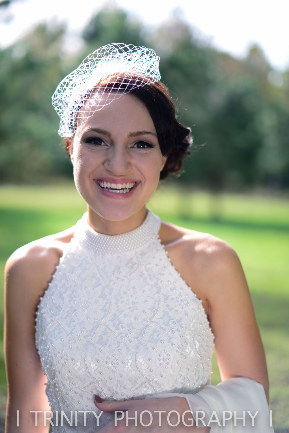 Jessica looked picture perfect in her birdcage veil and beaded vintage dress.