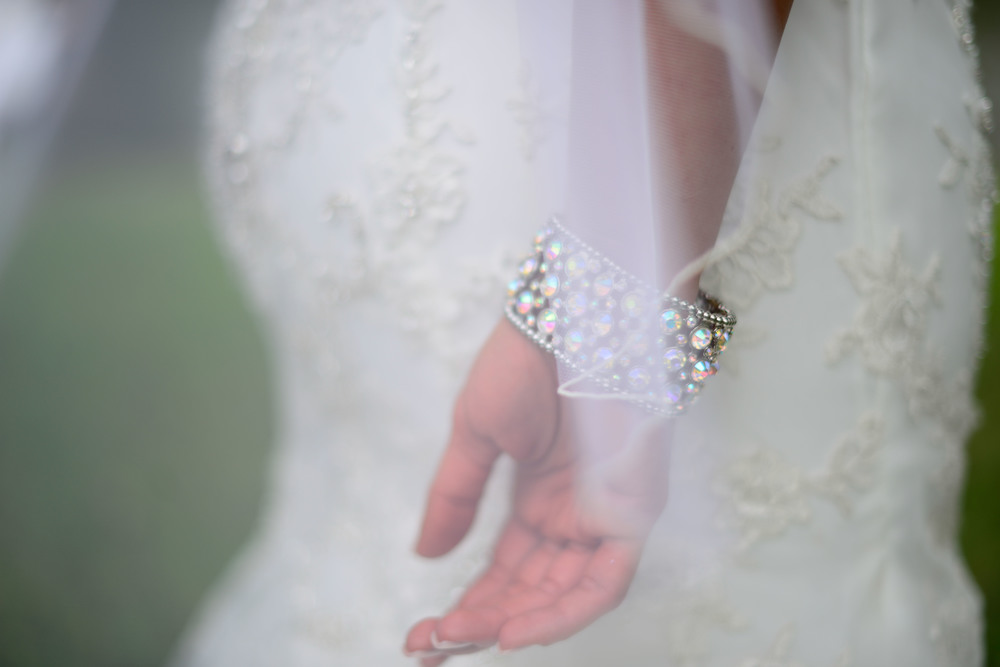 Creation: Detail of a Bride's Graceful hands on her Wedding day