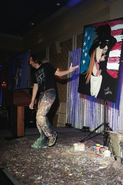 4. Artist Dave Santia's painting, which was later sold during the live auction