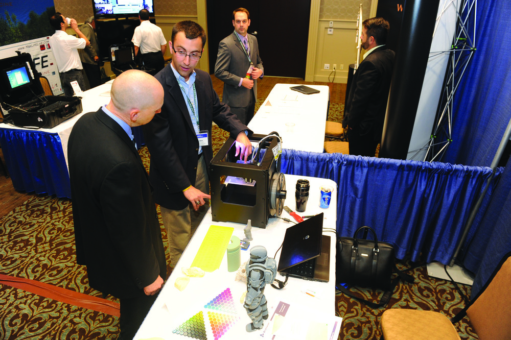 Jordan Cohen of DASI Solutions, LLC, shows 3D printing products
