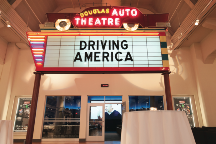 """The Beginning"" video played in the Douglas Auto Theatre throughout the evening."