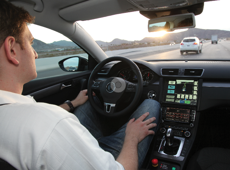 A Continental engineer monitors performance as an automated test vehicle steers, controls speed and maintains a safe distance from other vehicles. Photo courtesy Continental Corporation