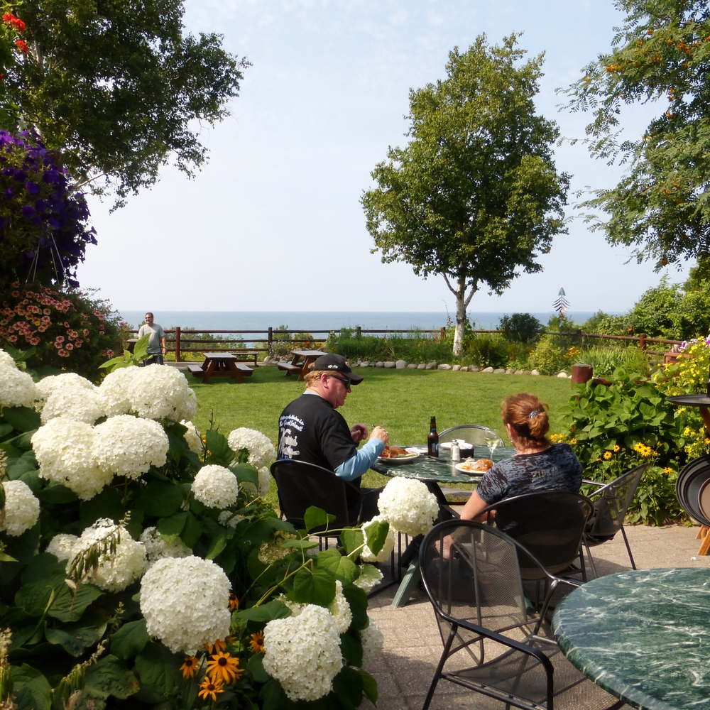 Diners often wait in long lines for a patio table at Legs Inn, overlooking Lake Michigan. Rustic and quirky, the restaurant specializes in Polish food, often served by a European waitstaff.