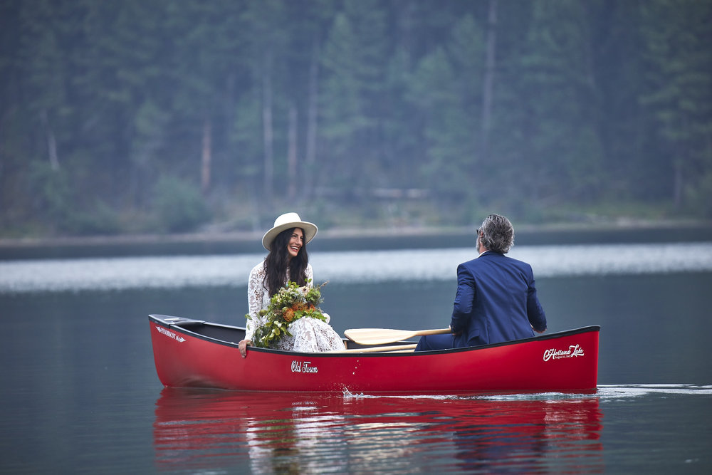 Best ceremony exit ever complete with the grooms gift to the bride-- a shiny new canoe!
