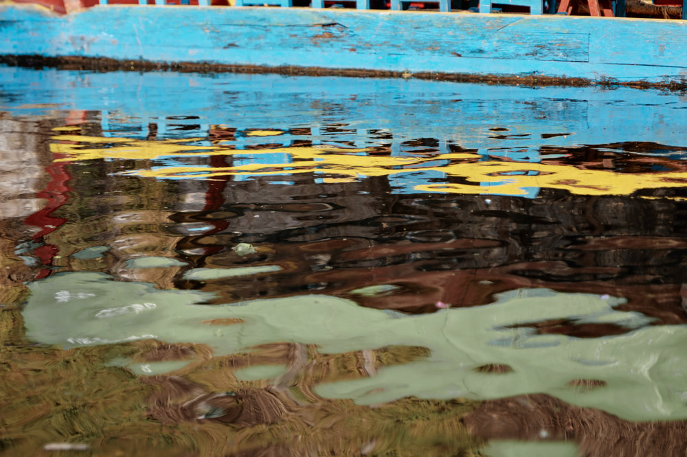 These are the murky waters of Xochimilco in Mexico City. Not the cleanest I've ever seen, but some of the reflections were just striking!
