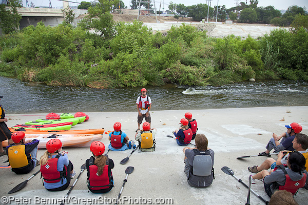 George Wolfe of LA River Expedition goes over safety measures and instructs the day's travellers on how to paddle and guide their kayaks for their 2.5 mile journey down the river.