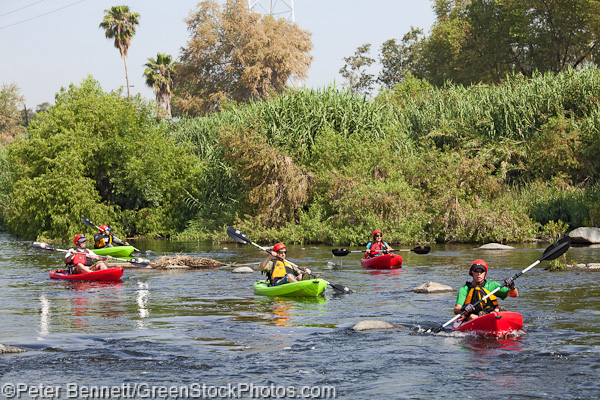 The boaters hit some open water as they get ready to traverse a series of small rapids.