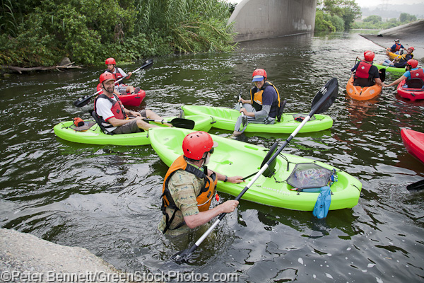The group waits for one of the boaters to get back in his kayak after a spill in the first rapids.