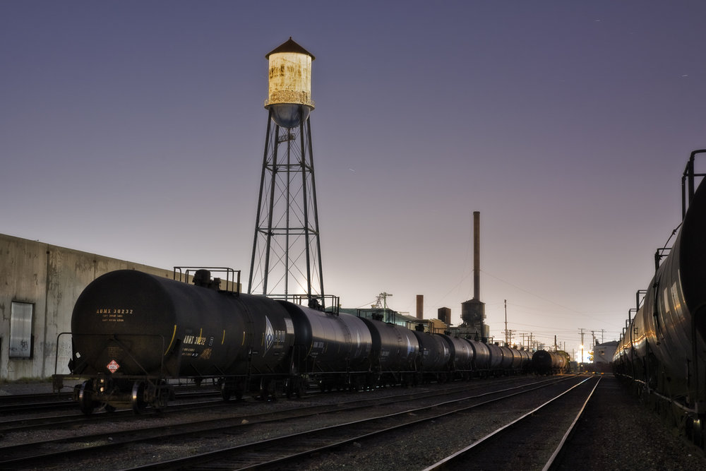 "Old Water tower in train yards on Vernon illuminated by moonlight. Located just a few miles from downtown Los Angeles, Vernon's official slogan is ""Exclusively Industrial"" and at the last census had a population of 91. Los Angeles, California, USA"