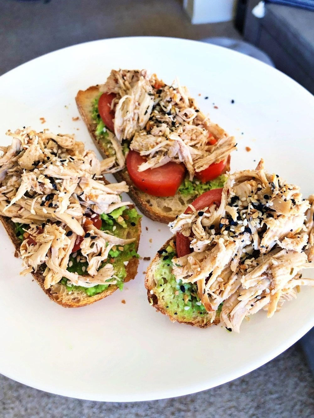 "Weekly meal prep idea. Instant Pot Salsa Shredded Chicken. This recipe is so easy, quick and tastes amazing. Sliced organic sourdough bread topped with mashed avocado, sliced tomatoes, salsa shredded chicken, and ""everything bagel"" seasoning. So freaking good!!"