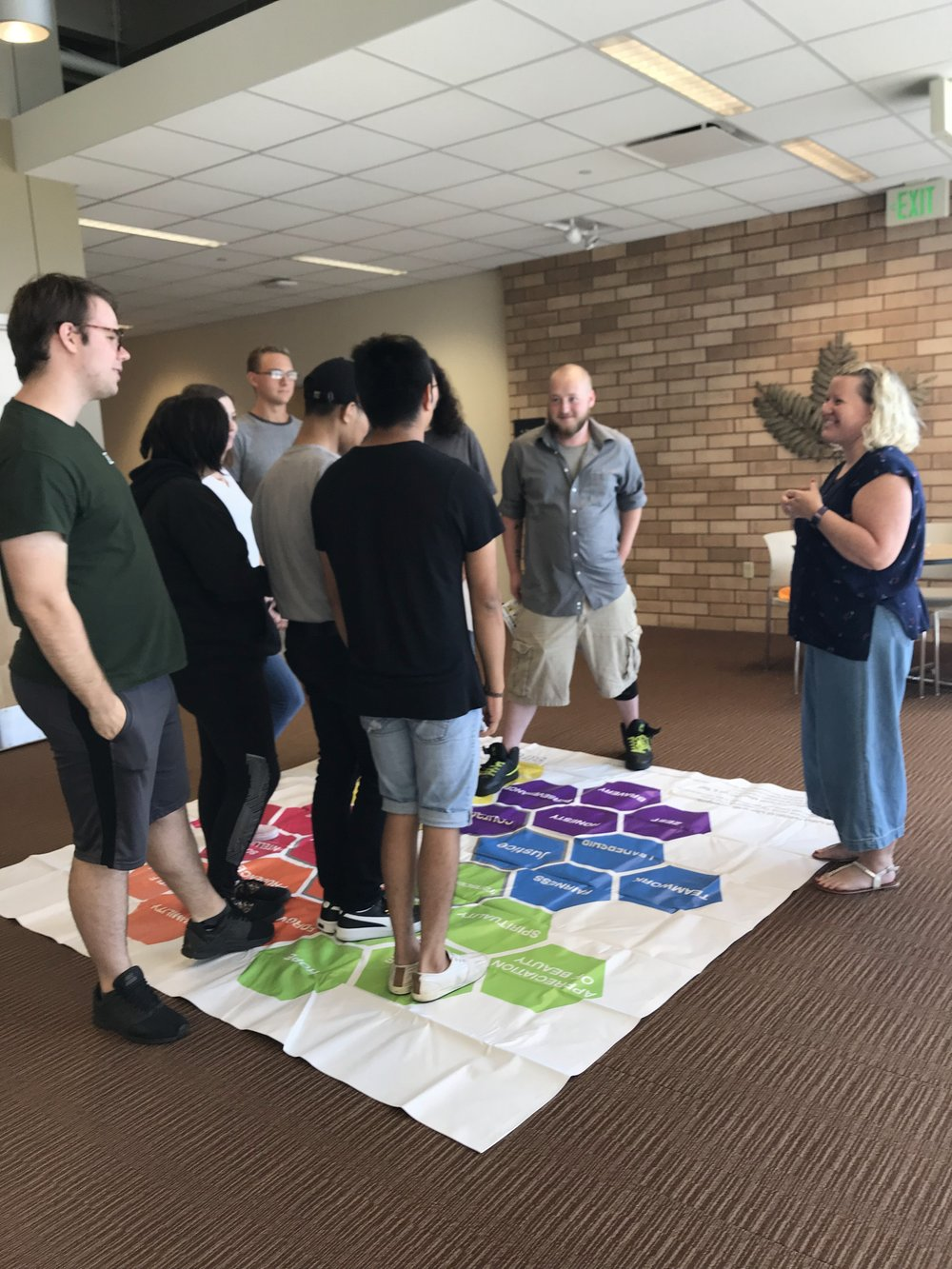 Erica leading students at Ivy Tech through a group coaching activity around seeing their character strengths and acknowledging them in each other.