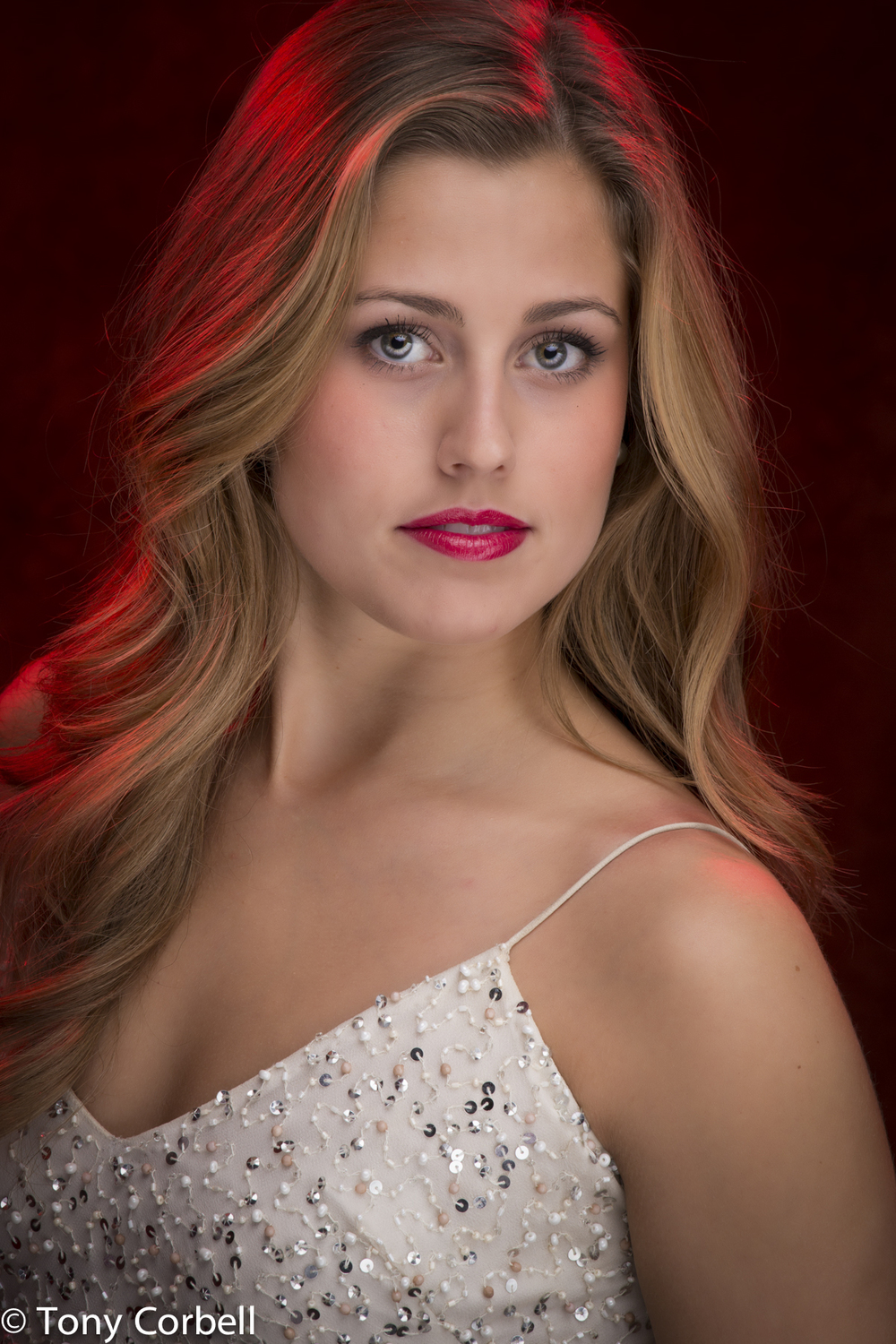 Ms. Kaitlyn York beautifully lit with impact provided by not only the lighting scheme but also the great eye contact.