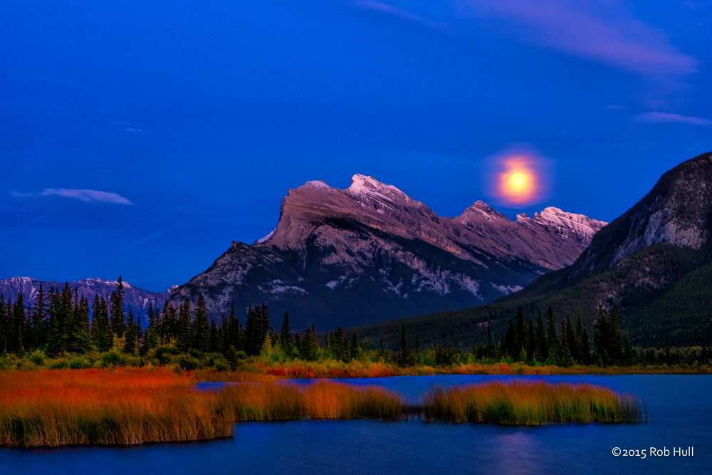 Moon rise over Mount Rundle and Vermilion Lake, Banff National Park, Canada.