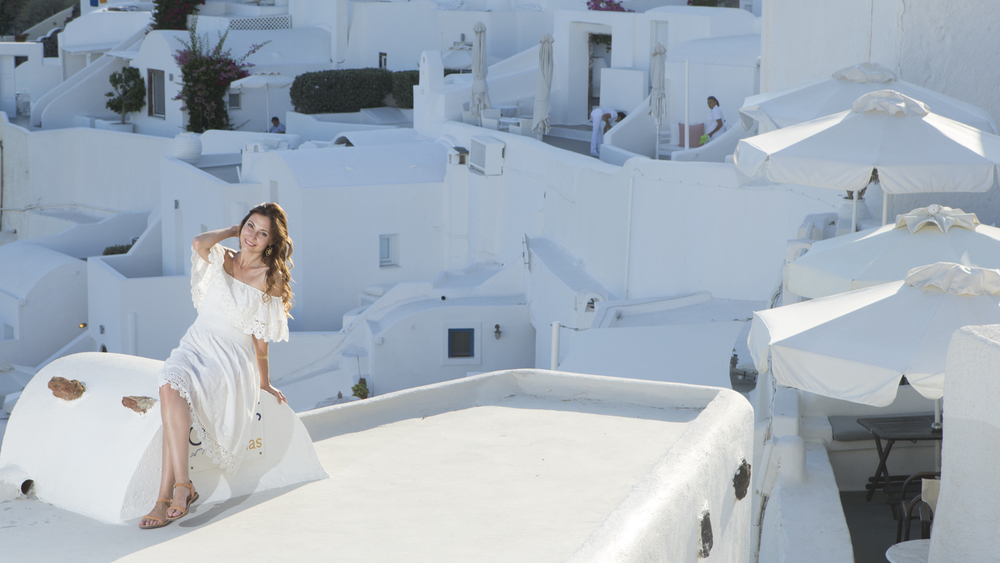 The beautiful Santorini and the beautiful Vlada balanced with Canon 600EX600 speedlight