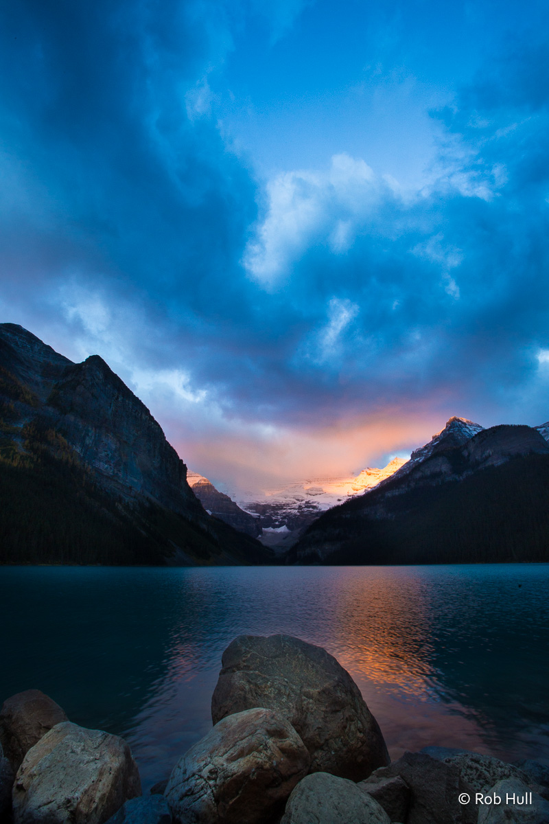 Sunrise on Lake Louise in Banff National Park, Canada. The morning was quite cold and a heavy overcast. The morning light was able to peek in for just a couple minutes before the clouds covered it once again.