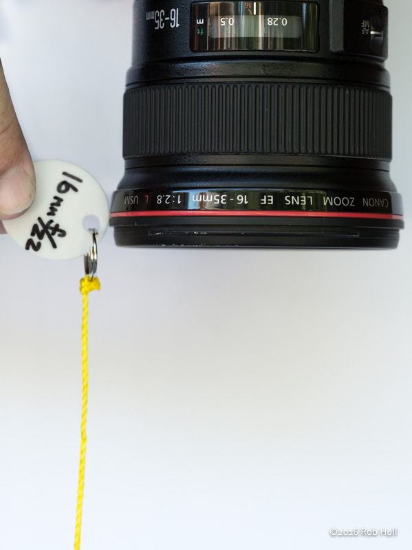 Using your handy dandy hyperfocal string, set your focus to the hyperfocal distance by holding the string at the end of the lens at a point when the fishing weight just touches the ground. Use autofocus to set the focus point at the hyperfocal distance.