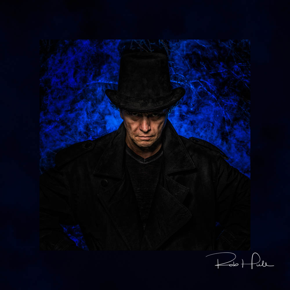 Boogie Man - I gelled the light for the background smoke using a blue gel that would be complementary the skin tone. This create a harmonious image.