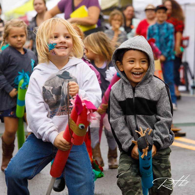 Kids have a stick horse race in Honoka'a during Western Week, a celebration of the towns paniolo (cowboy) heritage.