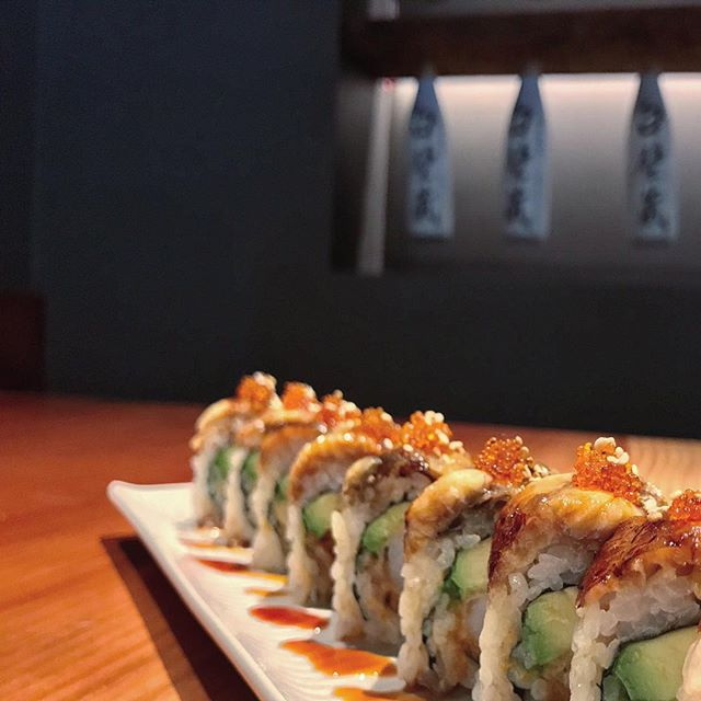 A close up of the Kamikaze Roll: tempura shrimp, ripe avocado, spicy tuna, real crab meat, topped with BBQ eel, toasted sesame, and tobiko for a finishing touch 🌀  ____________________________ #akemiberkeley #berkeley #solanoave #berkeleyeats #eastbay #eastbayeats #berkeleyrestaurants #bayarea #bayareaeats #sanfrancisco #oakland #japaneserestaurant #japanesefood #sushi #sushirestaurant #noms #sushitime #foodstagram #food #foodie#delish #dinner #healthy #foodgasm #instagood