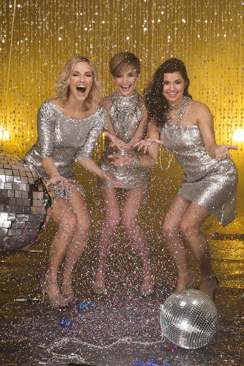 three girls breaking a pinata, discoball pinata, three girls celebrating, New Year, celebrity photographer, editorial photographer, commercial photographer, three girls throwing confetti