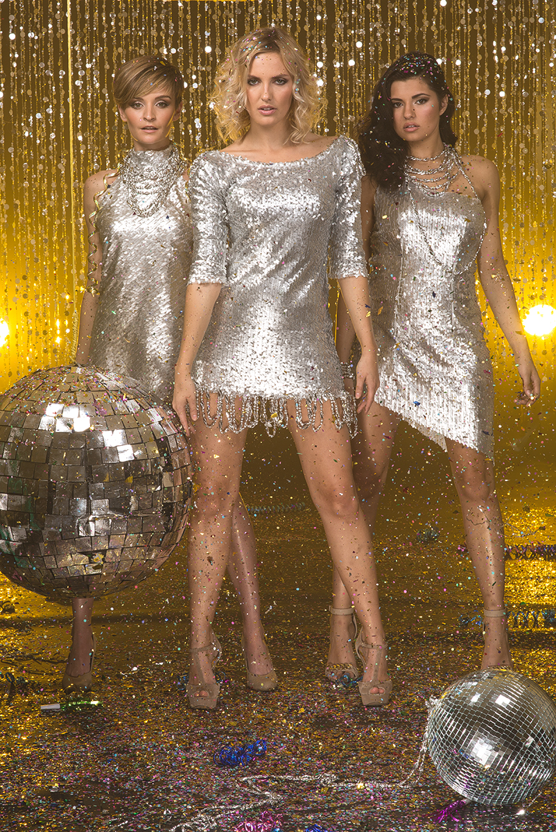 three girls breaking a pinata, discoball pinata, three girls celebrating, New Year, celebrity photographer, editorial photographer, commercial photographer, three girls posing with disco balls