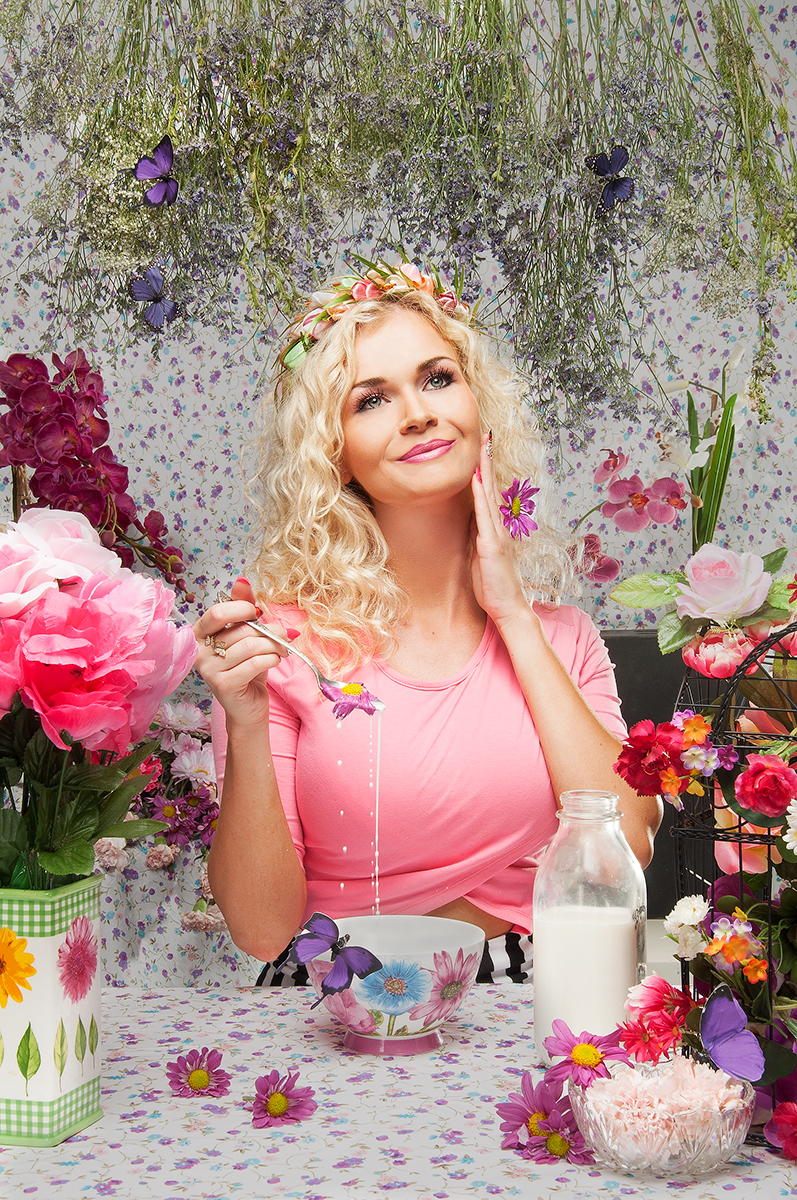 girl having flowers for breakfast, commercial photographer los angeles, conceptual portrait of smiling blonde girl, artistic portrait of beautiful blonde girl
