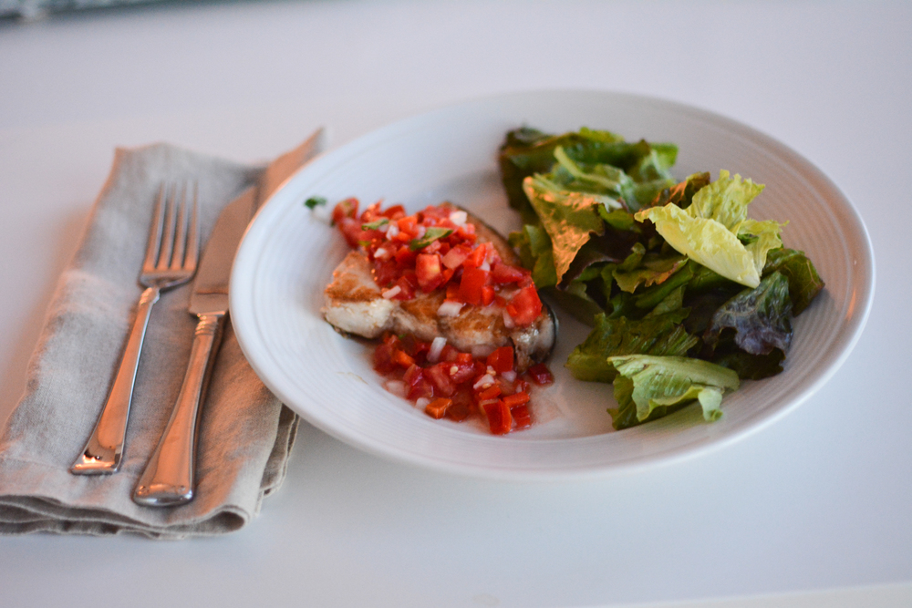 Pico de gallo served over swordfish steaks.